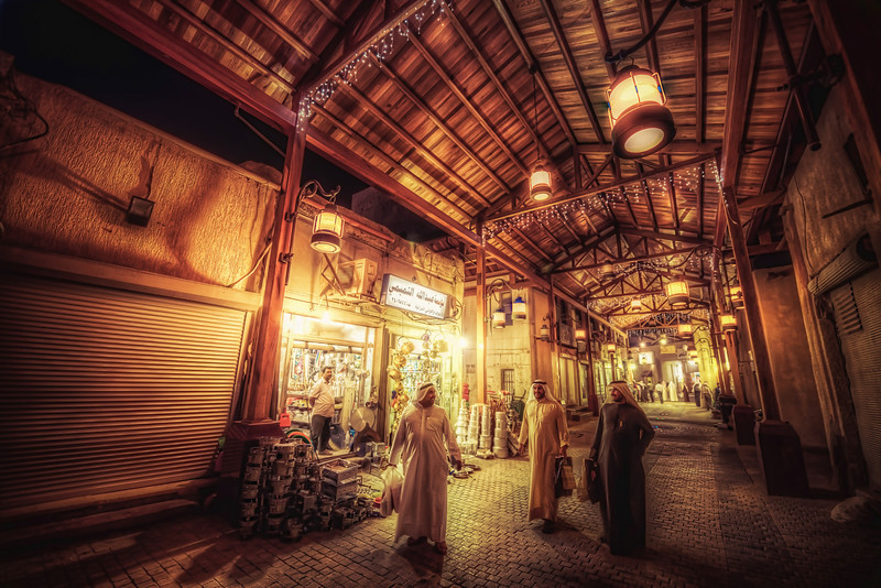 3 Kuwaiti men walking in Souk AlMubarakiya, one of the oldest markets in Kuwait.